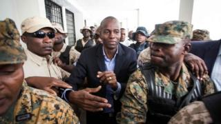 """Haiti""""s President-elect Jovenel Moise returns from the Cabinet d""""instruction to the Public Prosecutor""""s Office in Port-au-Prince on January 25, 2017"""
