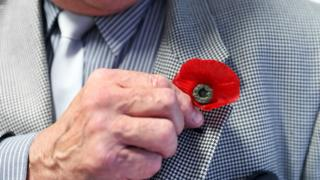 Bernie Axtell, 77, wears a poppy believed to date back to before World War Two