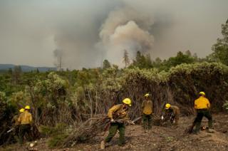 Firefighters from the Big Bear Hotshots create a firebreak as the Ferguson fire approaches in the Stanislaus National Forest, near Yosemite National Park, California, on 21 July 2018