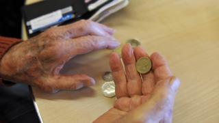 Pensioners' hands and money