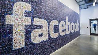 Facebook logo on wall