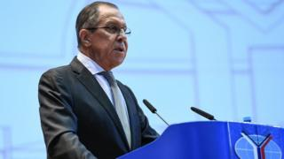 Sergei Lavrov at a podium talking