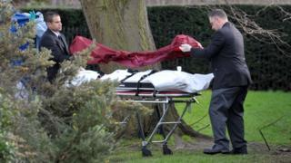 A body removed from the scene close to where a man died after setting himself on fire near Kensington Palace