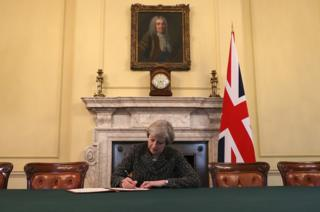 Theresa May signs the letter which will trigger Article 50, confirming the UK's departure from the EU.