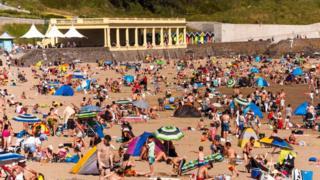 People sunbathing on the beach in Barry