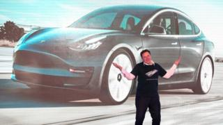 Tesla CEO Elon Musk gestures during the Tesla China-made Model 3 Delivery Ceremony in Shanghai.