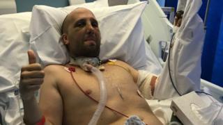 Tom Locke in his hospital bed in the trauma unit