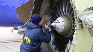 Image from NTSB shows an investigator examining damaged engine of Southwest Airlines flight 1380. 17 April 2018