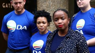 Phumzile Van Damme of the Democratic Alliance National speaks outside the Bell Pottinger offices in London