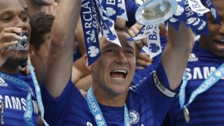 Chelsea skipper John Terry lifts the Premier League trophy