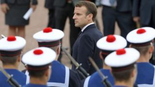 French President Emmanuel Macron reviews a troop of French navy soldiers during a ceremony commemorating General Charles De Gaulle's June 1940 appeal to French resistance against Nazi Germany on June 18, 2018