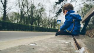 Child sitting on bench