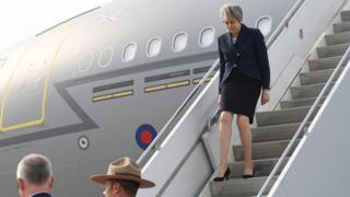Theresa May arrives in Canada