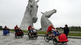 Public Health and Sport Minister Aileen Campbell (right) chats with with Mary Duncan, 90, Jim Taylor, 96, and volunteer Harry Wilson during the launch of Cycling Without Age Scotland at the Kelpies in Falkirk