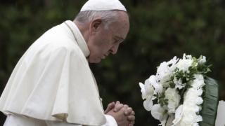 Pope Francis prays after laying a wreath to the Hypocenter Cenotaph at the Atomic Bomb Hypocenter Park