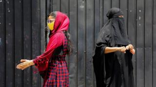 Sri Lankan ethnic Muslim women wait in a queue for the Covid-19 blood test in Colombo, Sri Lanka, 04 May 2020