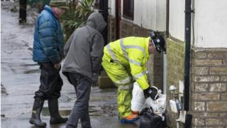 in_pictures Residents lay sandbags down outside their homes in Mytholmroyd, West Yorkshire in preparation for the storm
