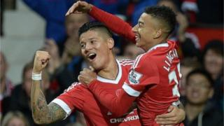 Manchester United's Jesse Lingard (R) celebrates scoring his team's first goal with team mate Marcos Rojo