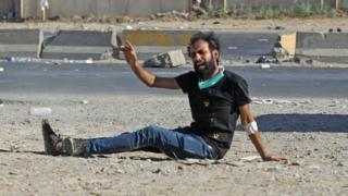 An Iraqi protester gestures after being shot during a demonstration in Baghdad on 4 October 2019