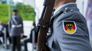 Bundeswehr soldiers stand guard during a meeting at the Chancellery in Berlin