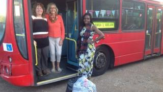 Landlady Eunice Jokrassett and two members of the fundraising committee stand with the bus