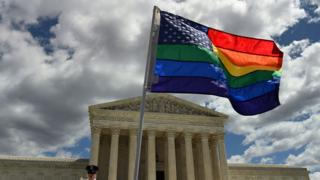 A supporter of gay marriage waves his rainbow flag in front of the U.S. Supreme Court in Washington DC.