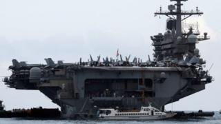 The USS Theodore Roosevelt enters port in Vietnam