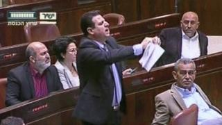 Arab MP Ayman Odeh ripped the 'muezzin bill' up in the Knesset (8 March 2017)