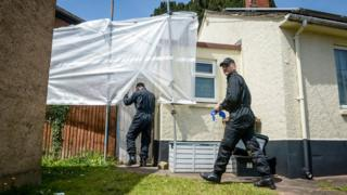 Search officers enter the house in Bradninch