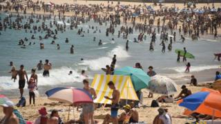 Sunbathers are seen on Bondi Beach as temperatures soar in Sydney on December 28, 2018