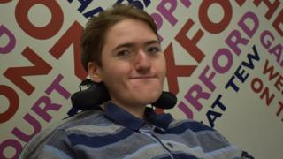 Ben in front of a BBC Local Radio sign
