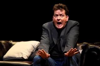US actor Charlie Sheen speaks during An Evening with Charlie Sheen at the Theatre Royal, Drury Lane in London