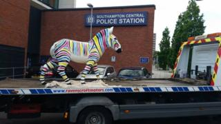 Gilbert on the back of a recovery lorry outside Southampton Police Station