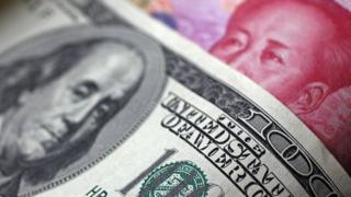 A 100 dollar bill and a 100 yuan note