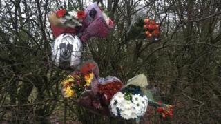 Flowers left after the crash on Thursday at Sculthorpe, near Fakenham