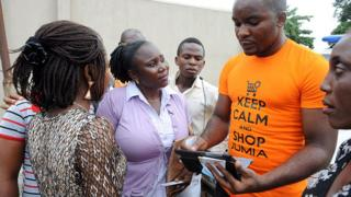 Technology A Jumia saleman tries to market products to bystanders in Lagos on June 12, 2013.