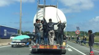 Migrants on the back of a tanker