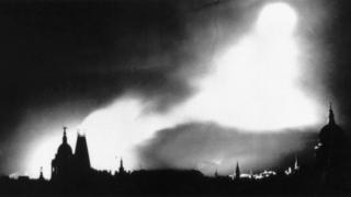 Bombs lighting the night sky over London during the Blitz.