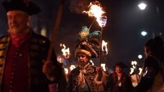 Revellers' torches are carried through the streets of Lewes in East Sussex