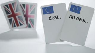 "Playing cards with ""deal"" or ""no deal"" written on them"