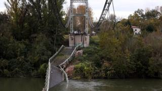 View of a suspension bridge collapsed in the Tarn river