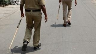 Police with sticks. File photo
