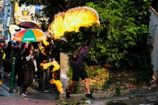 A protester throws a petrol bomb in Hong Kong