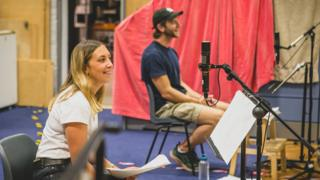 Hollie Chapman and Wilf Scolding, who play Alice and Christopher Carter, recording The Archers