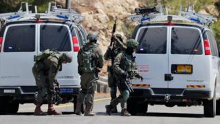 Israeli troops gather at the site of a bomb explosion that killed an Israeli teenager, near the settlement of Dolev in the occupied West Bank (23 August 2019)