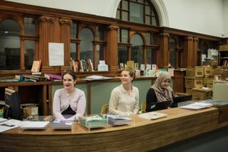 Volunteers Julie Lee (left) and Houida (right), with volunteer coordinator Gabrielle Macbeth (centtr) at the Glasgow Women's Library