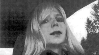 Chelsea Manning wears a wig while sitting in a car