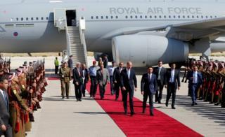 Prince William arrives at Marka Airport and meets Jordan's Crown Prince Hussein bin Abdullah II
