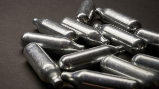 Nitrous oxide is sold in metal canisters often discarded in the street