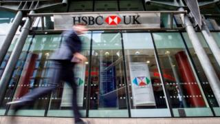 Man walks past HSBC branch in UK